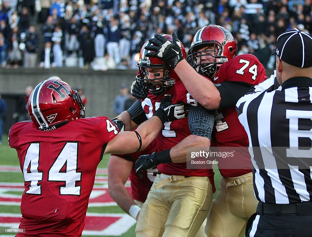 Harvard's Cameron Brate caught a fourth quarter touchdown, as Parker Sebastian, right, and Scott Peters celebrate with him, as Harvard University hosts Yale University during their annual game, Nov. 17, 2012 at Harvard Stadium.