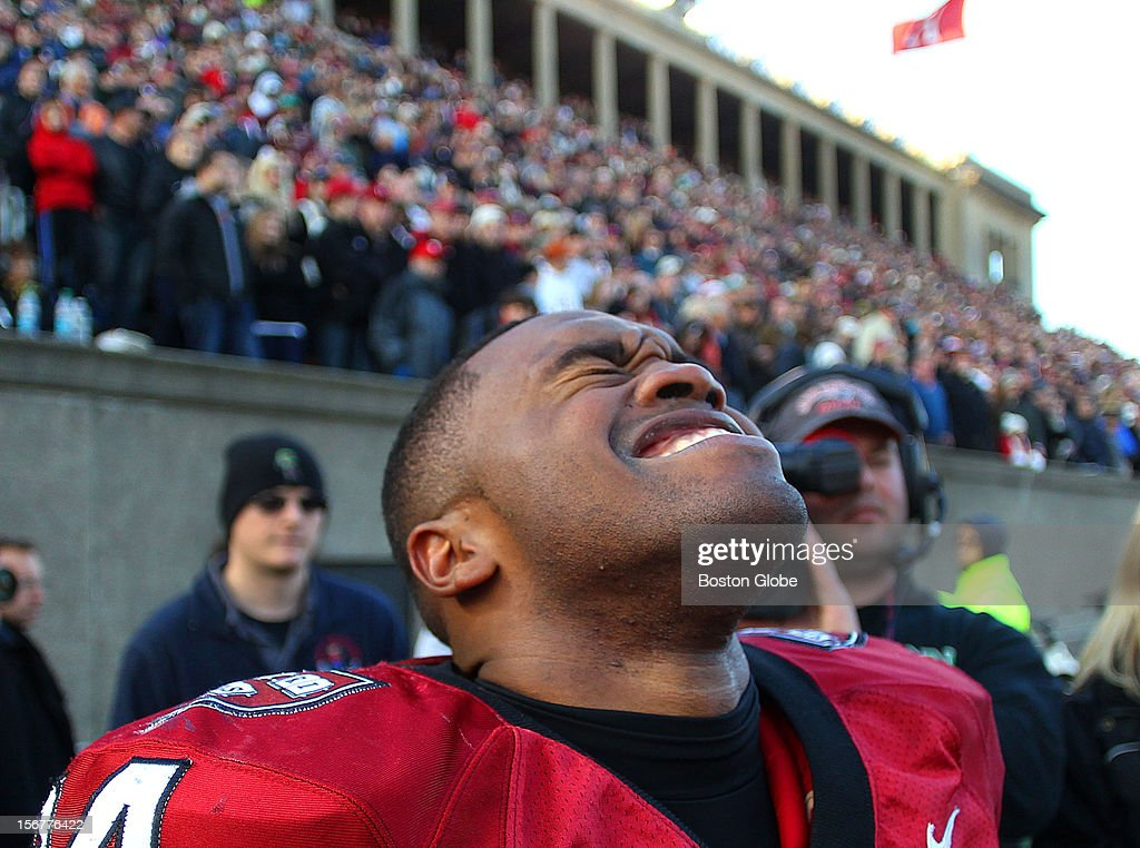 Harvard's Treavor Scales reacts on the sidelines after his long fourth quarter touchdown to seal the win for Harvard as Harvard University hosts Yale University during their annual game, Nov. 17, 2012 at Harvard Stadium.