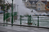 Telephoto image of a Spring high tide breaking over the coast road a typical Victorian seaside area, nostalgic in the Summer.