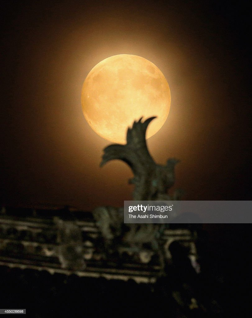A harvest moon is seen over Nagoya Castle on September 8 2014 in Nagoya Aichi Japan
