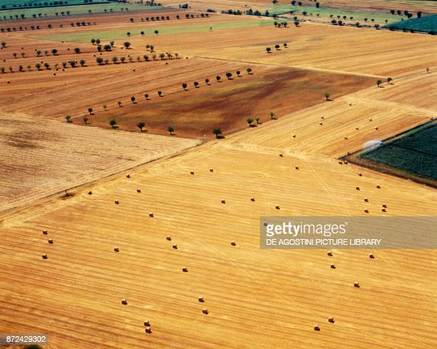 Harvested fields with bales of hay in the countryside of Piacenza EmiliaRomagna Italy