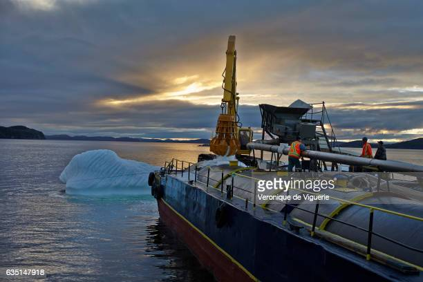 Harvesting of the first iceberg chosen by Ed Kean As more icebergs drift south due to climate change a few enterprising seafarers have begun...