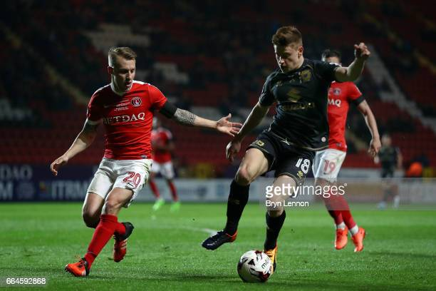 Harvey Barnes of Milton Keynes Dons holds off Chris Solly of Charlton Athletic during the Sky Bet League One match between Charlton Athletic and...