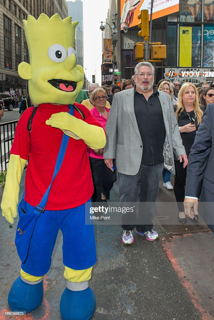 <a gi-track='captionPersonalityLinkClicked' href=/galleries/search?phrase=Harvey+Fierstein&family=editorial&specificpeople=206751 ng-click='$event.stopPropagation()'>Harvey Fierstein</a> leads the crowd to The <a gi-track='captionPersonalityLinkClicked' href=/galleries/search?phrase=Harvey+Fierstein&family=editorial&specificpeople=206751 ng-click='$event.stopPropagation()'>Harvey Fierstein</a> 15-Bite Brooklyn Diner 'All Beef' Hot Dog Unveiling at Brooklyn Diner on May 22, 2013 in New York City.