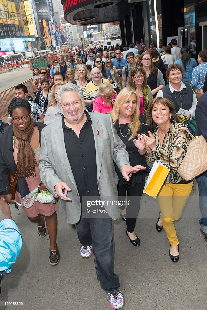 Harvey Fierstein leads the crowd to The Harvey Fierstein 15-Bite Brooklyn Diner 'All Beef' Hot Dog Unveiling at Brooklyn Diner on May 22, 2013 in New York City.
