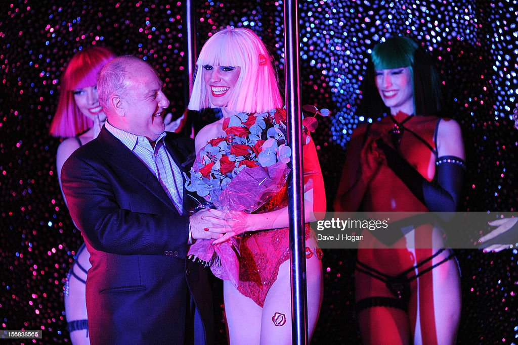 Harvey Goldsmith presents Kelly Brook with flowers at her final show with Crazy Horse at The Forever Crazy Spiegel Tent on November 22, 2012 in London, England.
