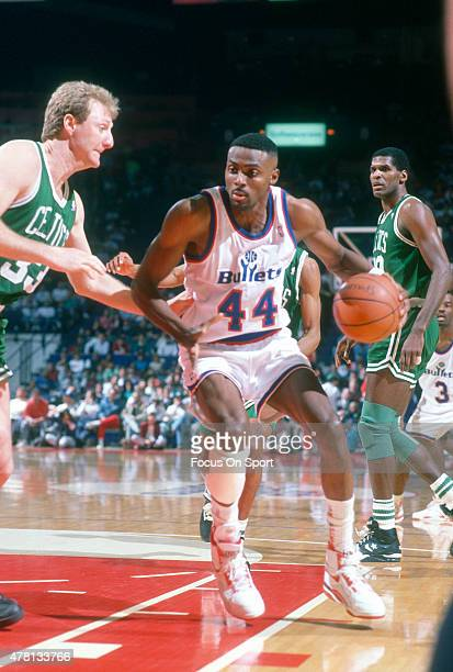 Harvey Grant of the Washington Bullets backs in on Larry Bird of the Boston Celtics during an NBA basketball game circa 1991 at the Capital Centre in...