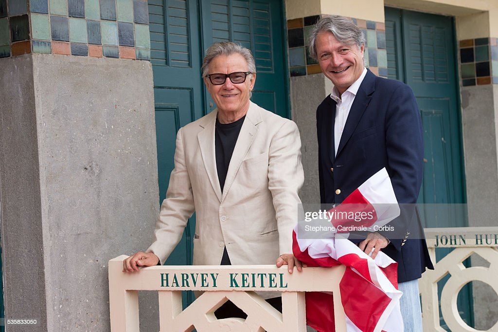 Harvey Keitel and Deauville Mayor Philippe Augier attend an homage ceremony at Promenade des planches during the 38th Deauville American Film...