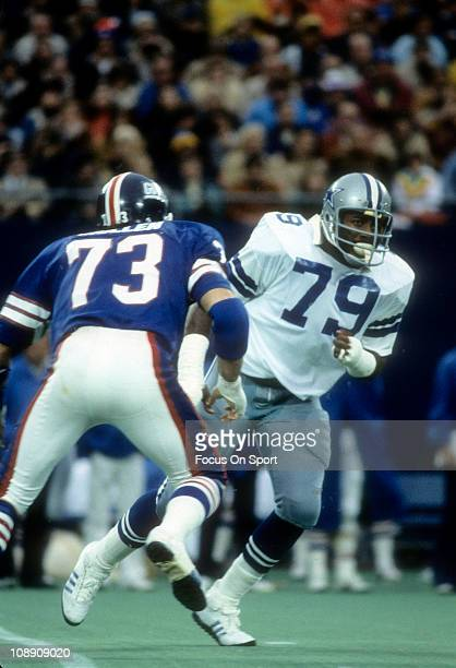 Harvey Martin of the Dallas Cowboys tries to get pass Kevin Belcher of the New York Giants during an NFL football game at Giant Stadium October 30...