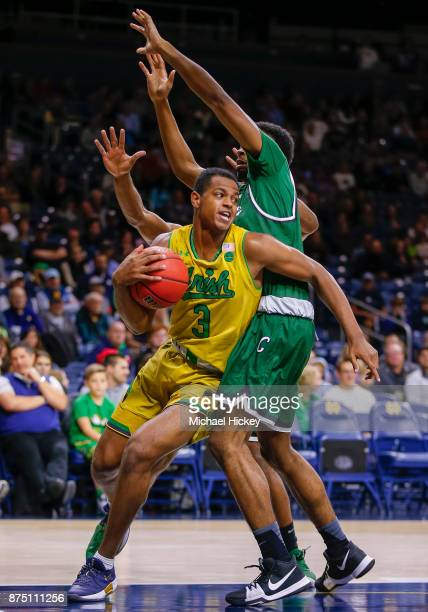 J Harvey of the Notre Dame Fighting Irish pivots around Jalen StephensHolmes of the Chicago State Cougars at Purcell Pavilion on November 16 2017 in...