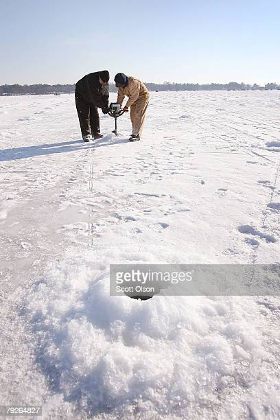 Harvey Paradeis and Randy Pederson help drill holes in the ice on Gull Lake ahead of the Brainerd Jaycees Ice Fishing Extravaganza fishing tournament...
