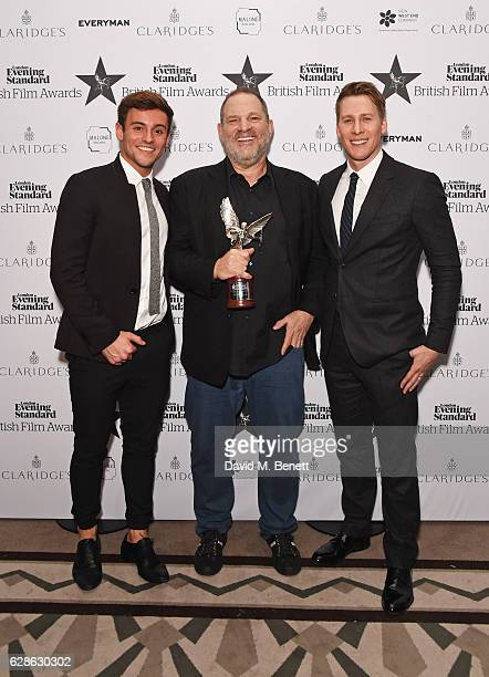 Harvey Weinstein accepting the Best International Film of the Year award for 'Lion' poses with presenters Tom Daley and Dustin Lance Black at The...
