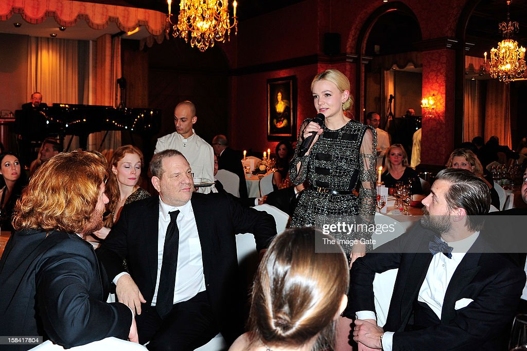 Harvey Weinstein and Carey Mulligan attend the ASMALLWORLD Gala Dinner for Alzheimer Society at the Gstaad Palace Hotel on December 15, 2012 in Gstaad, Switzerland.