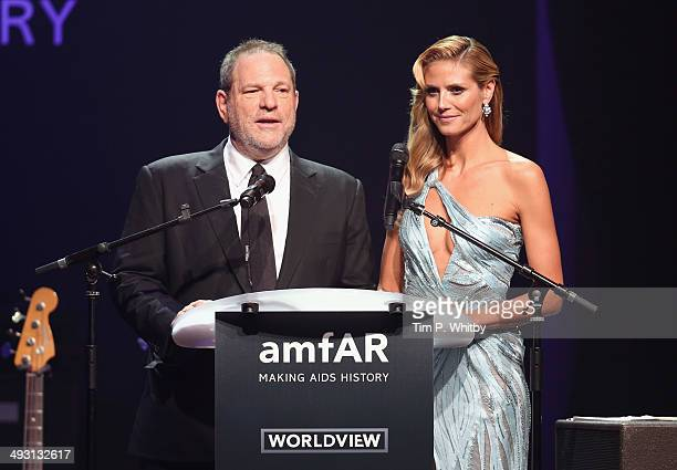 Harvey Weinstein and Heidi Klum speak onstage during amfAR's 21st Cinema Against AIDS Gala Presented By WORLDVIEW BOLD FILMS And BVLGARI at Hotel du...