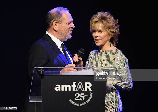 Harvey Weinstein and Jane Fonda onstage at amfAR's Cinema Against AIDS Gala during the 64th Annual Cannes Film Festival at Hotel Du Cap on May 19...