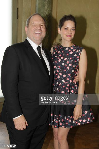 Harvey Weinstein and Marion Cotillard attend the Christian Dior HauteCouture Show as part of Paris Fashion Week Fall / Winter 2013 on July 2 2012 in...