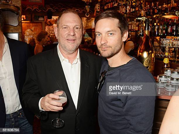 Harvey Weinstein and Tobey Maguire attend a starstudded dinner hosted by DEAN DELUCA Harvey Weinstein Charles Finch to celebrate Robert De Niro in...