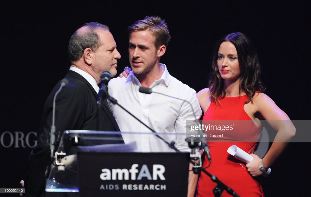 Harvey Weinstein, Ryan Gosling and actress Emily Blunt speak during amfAR's Cinema Against AIDS 2010 benefit gala at the Hotel du Cap on May 20, 2010 in Antibes, France.