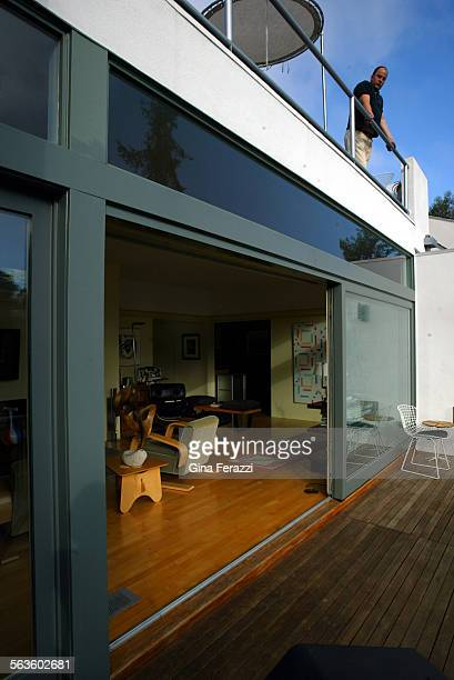 Harwell Harris house has a Streamline Moderne exterior with a white curved porte cochere in front and a round bedroom wall in back overlooking Santa...