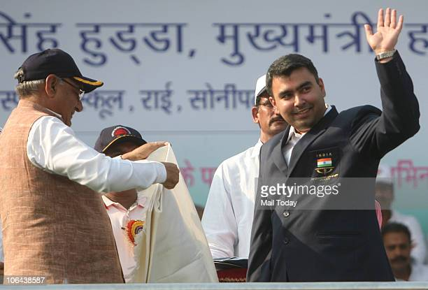Haryana Chief Minister Bhupinder Singh Hooda honours Commonwealth Games medal winning shooter Gagan Narang during a function to celebrate the 44th...