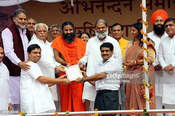 Haryana Chief Minister Manohar Lal and Yogrishi Swami Ramdev being presented a copy of Memorandum of Understanding signed between Patanjali Yogpeeth...