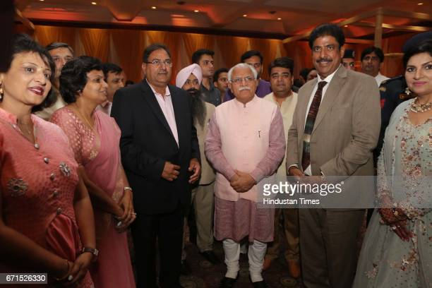 Haryana Chief Minister Manohar Lal Khattar during the wedding reception of INLD MP Dushyant Chautala with Meghna Ahlawat at Ashoka Hotel on April 20...