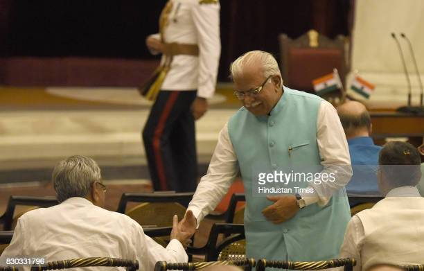 Haryana Chief Minister Manohar Lal Khattar hand shakes with Bihar chief minister Nitish Kumar during the 13th VicePresident of India sworn ceremony...