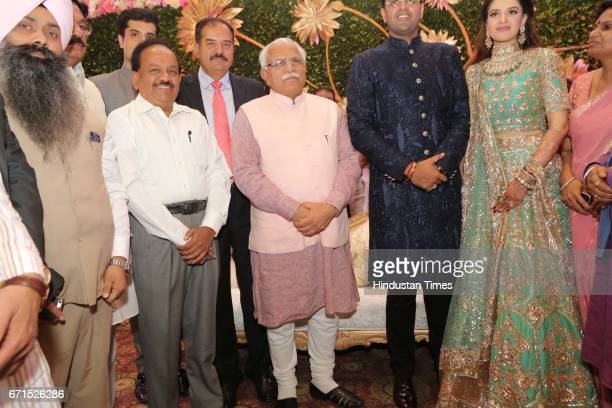 Haryana Chief Minister Manohar Lal Khattar Union minister Harsh Vardhan with INLD MP Dushyant Chautala and Meghna Ahlawat during their wedding...