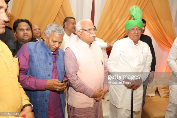 Haryana Chief Minister Manohar Lal Khattar with former Haryana Chief Minister Om Prakash Chautala during the wedding reception of INLD MP Dushyant...
