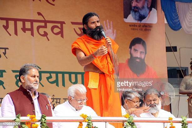 Haryana Chief Minister Manohar Lal with Yoga Guru Baba Ramdev during the felicitation function organized to honor Swami Ramdev on his appointment as...