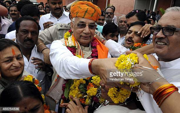 Haryana Governor Kaptan Singh Solanki welcomed by BJP workers at Indore airport on September 11 2014 in Indore India President Pranab Mukherjee...