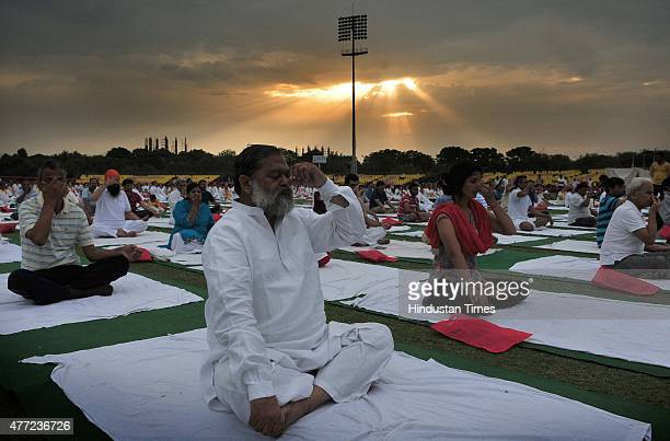 Haryana Health minister Anil Vij and participants during the Yoga training camp organized by Baba Ramdev's Patanjali Yogpeeth for the celebrations of...