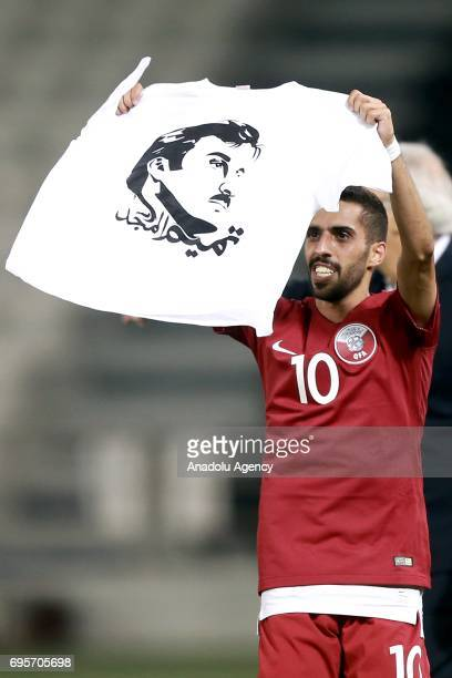 Hasan Al Haydos of Qatar waves a tshirt portrait of Tamim bin Hamad Al Thani printed on it as he celebrates his score during the 2018 FIFA World Cup...