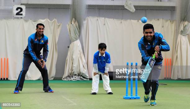 Hasan Ali and Haris Sohail of Pakistan play cricket with local school children during an ICC Champions Trophy Cricket for Good clinic at Edgbaston on...