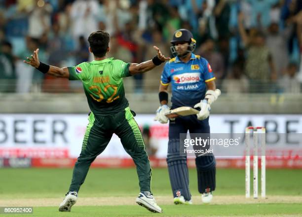 Hasan Ali of Pakistan celebrate after dismissing Kusal Mendis of Sri Lanka during the first One Day International match between Pakistan and Sri...