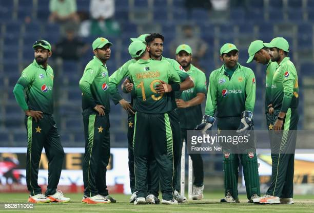 Hasan Ali of Pakistan celebrates with teammates after dismissing Akila Dananjaya of Sri Lanka during the third One Day International match between...