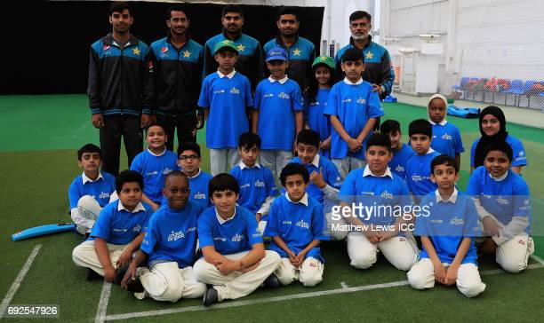 Hasan Ali of Pakistan pictured with team mates Haris Sohail Babar Azam Shadab Khan with local school children during an ICC Champions Trophy Cricket...