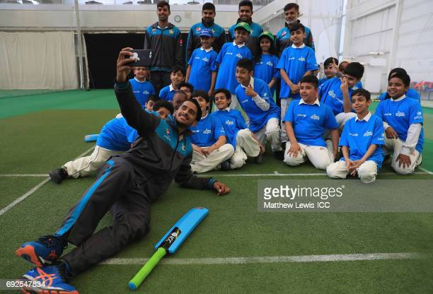 Hasan Ali of Pakistan takes a selfie with local school children and team mates Haris Sohail Babar Azam Shadab Khan during an ICC Champions Trophy...