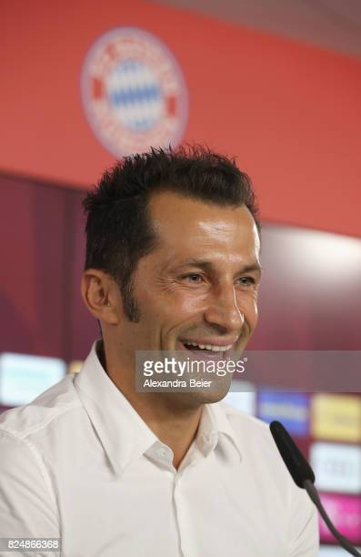 Hasan Salihamidzic new assigned sports director of FC Bayern Muenchen laughs as he answers journalists' questions during a news conference at...