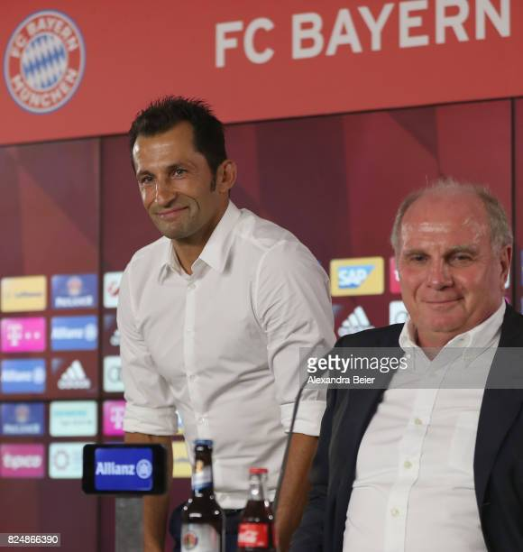 Hasan Salihamidzic new assigned sports director of FC Bayern Muenchen and FC Bayern Muenchen president Uli Hoeness arrive for a news conference at...
