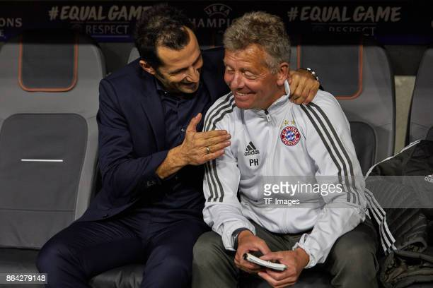 Hasan Salihamidzic of Bayern Muenchen and Assistent coach Peter Hermann of Bayern Muenchen looks on during the UEFA Champions League group B match...