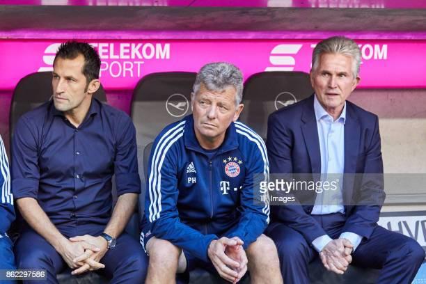 Hasan Salihamidzic of Bayern Muenchen Assistent coach Peter Hermann of Bayern Muenchen and Head coach Jupp Heynckes of Bayern Muenchen looks on...