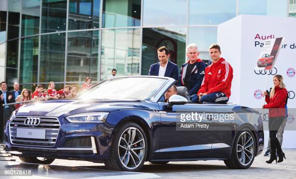 Hasan Salihamidzic sporting director Jupp Heynckes head coach and Thomas Mueller of Bayern Muenchen ride in the back of an Audi S5 during the FC...