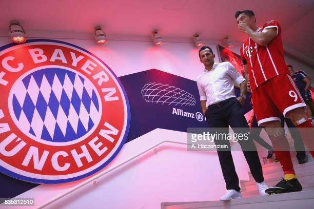 Hasan Salihamidzic Sporting director of Bayern Muenchen looks on with his player Robert Lewandiowski prior to the Bundesliga match between FC Bayern...