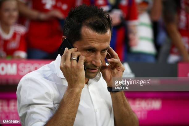 Hasan Salihamidzic Sporting director of Bayern Muenchen talks on the phone prior the Bundesliga match between FC Bayern Muenchen and Bayer 04...