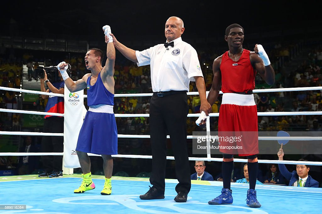 Hasanboy Dusmatov of Uzbekistan celebrates winning gold after defeating Yuberjen Herney Martinez of Colombia in the Men's Boxing Light Fly Final on...