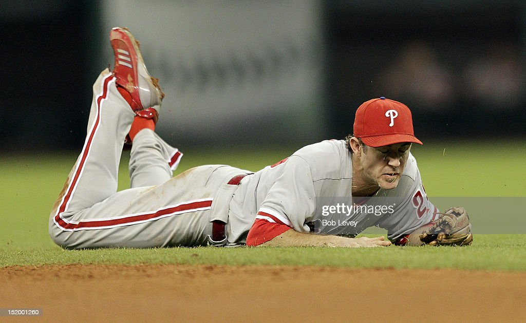 C hase Utley #26 of the Philadelphia Phillies dives but comes up short on a ground ball to right field against the Houston Astros at Minute Maid Park on September 14, 2012 in Houston, Texas.