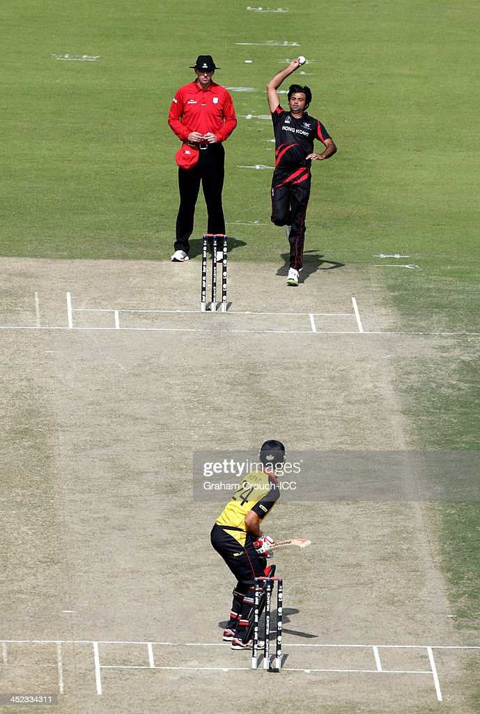 Haseeb Amjad of Hong Kong bowling during of the Papua New Guinea v Hong Kong Quarter Final match at the ICC World Twenty20 Qualifiers at the Zayed Cricket Stadium on November 28, 2013 in Abu Dhabi, United Arab Emirates.
