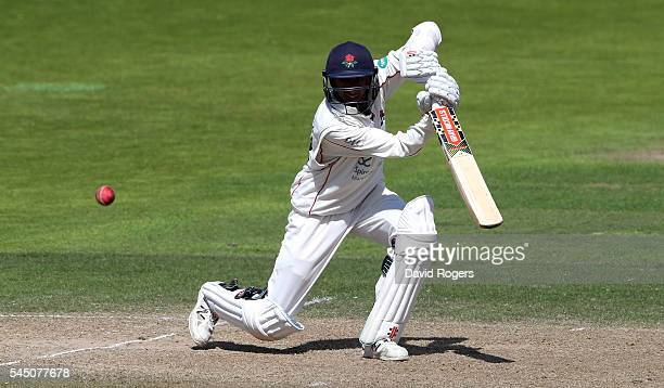 Haseeb Hameed of Lancashire drives for four runs during the Specsavers County Championship division one match between Nottinghamshire and Lancashire...