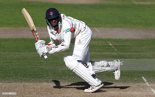 Haseeb Hameed of Lancashire scores four runs during the Specsavers County Championship division one match between Nottinghamshire and Lancashire at...
